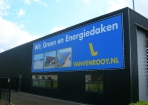 Mega spandoek Van Venrooy reclame in buisframe
