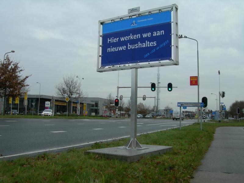 Dubbelzijdige reclame spandoek Bushalte