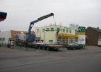 Lichtreclame vervoer transport naar dak Hup en Fidom